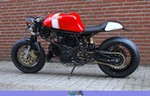 Production (Stock) Ducati Monster Series, Production (Stock)- Ducati  Monster Series Motorcycle a red and black Ducati Monster Series Streetbike parked in front of a brick building