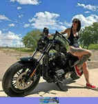 Production (Stock) Harley-Davidson Unknown (HD), Cute model with a cool custom motorcycle! a person sitting on a Harley-Davidson  Streetbike
