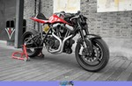 Production (Custom) Harley-Davidson Unknown (HD), a red and black motorcycle is parked on the side of a building a red and black Harley-Davidson  Streetbike is parked on the side of a building