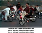 Production (Custom) Honda CB Models, A Pakistani youth does a wheelie on his motorcycle adorned with a U.S. flag as others watch him on a road on the outskirts of Islamabad Friday evening Nov. 9, 2001. (AP Photo/Peter Dejong)  Go to http://dailynews.yahoo.com/h/p/ap/20011110/wl/1005389230pakistan_attacks_isl102.html to check it out.