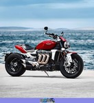 Production (Stock) Triumph Rocket 3, a red motorcycle parked on the beach a red 2020 Triumph Rocket 3 Streetbike parked on the beach