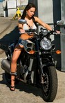 Women Yamaha V-Max, Women- Yamaha  V-Max Motorcycle a woman sitting on a Yamaha V-Max Streetbike