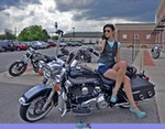 Women Harley-Davidson Road King, Hot babe with a Harley Davidson Road King motorcycle a person sitting on a Harley-Davidson Road King Streetbike in a parking lot