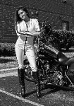 Women Harley-Davidson Road King, Hot babe with a Harley Davidson Road King motorcycle. a woman standing in front of a Harley-Davidson Road King Streetbike