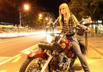 Women Harley-Davidson Softail, Hot babe with a Harley Davidson Softail motorcycle. a person riding a Harley-Davidson Softail Streetbike down a street