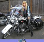 Women Harley-Davidson Softail, Lovely woman on a Harley Davidson/Softail motorcycle. Michelle DellaFave sitting on a Harley-Davidson Softail Streetbike in front of a building