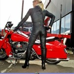 Women Harley-Davidson Road King, hot babe on a Harley Davidson/Road King motorcycle. a person wearing a red and black Harley-Davidson Road King Streetbike