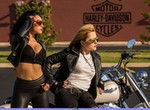 Women Harley-Davidson Softail, Hot babes on a Harley Davidson/Softail motorcycle.