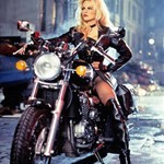 Women Triumph Unknown (Triumph), Pamela Anderson sitting on a motorcycle Pamela Anderson riding on a Triumph  Streetbike
