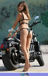 Women Triumph Rocket 3, a woman standing in front of a motorcycle a woman with a Triumph Rocket 3 Streetbike