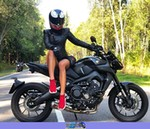 Women Yamaha Unknown (Yamaha), A woman wearing a helmet sitting on a black Yamaha FZ09 a person sitting on a Yamaha  Streetbike