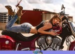 Women Indian Chief Models, a woman laying on a motorcycle a woman with a red and black Indian Chief Streetbike