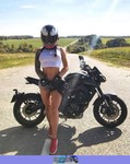 Women Yamaha Unknown (Yamaha), a person wearing a helmet and sitting on a Yamaha FZ-09 a person wearing a helmet and sitting on a Yamaha  Streetbike