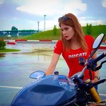 Women Ducati Monster Series, a person wearing a blue shirt sitting on a motorcycle a person wearing a blue shirt sitting on a Ducati Monster Series Streetbike