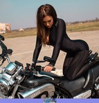 Women Yamaha V-Max, a person sitting on a motorcycle a person sitting on a Yamaha V-Max Streetbike