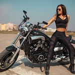 Women Yamaha V-Max, a woman sitting on a motorcycle a woman sitting on a Yamaha V-Max Streetbike