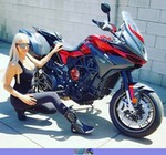 Women Yamaha V-star 650, a person sitting on a motorcycle a person sitting on a Yamaha V-star 650 Streetbike
