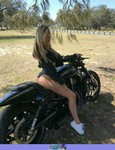 Women Harley-Davidson Unknown (HD), a person sitting on a motorcycle