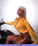 Women Harley-Davidson Unknown (HD), Maria sitting on a motorcycle