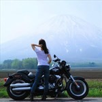 Women Harley-Davidson Unknown (HD), a woman sitting on a motorcycle in front of a mountain
