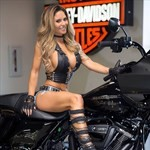 Women Harley-Davidson Unknown (HD), a woman sitting on a motorcycle