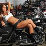 Women Harley-Davidson Unknown (HD), a woman sitting on a motorcycle a woman sitting on a Harley-Davidson  Streetbike