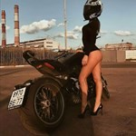 Women Ducati Diavel, a woman standing in front of a beach