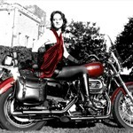 Women Harley-Davidson Softail, Attractive woman sitting on a Hatley Davidson/Softail motorcycle. a red and black Harley-Davidson Softail Streetbike