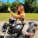 Women Ducati Monster Series, a person sitting on a motorcycle a person sitting on a Ducati Monster Series Streetbike
