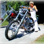 Women Harley-Davidson Unknown (HD), a person standing in front of a motorcycle a person standing in front of a Harley-Davidson  Streetbike