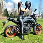 Women Yamaha FZ/MT Models, a woman sitting on a motorcycle in a field